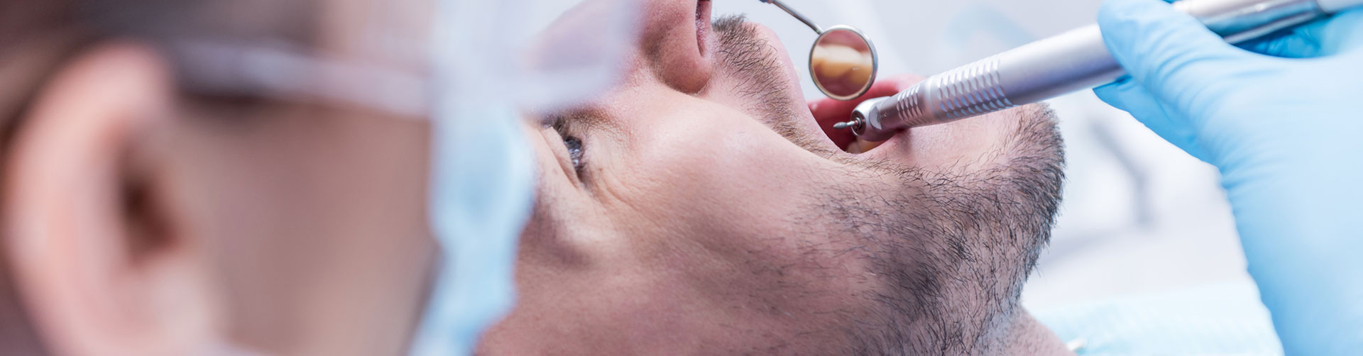 man having tooth treatment